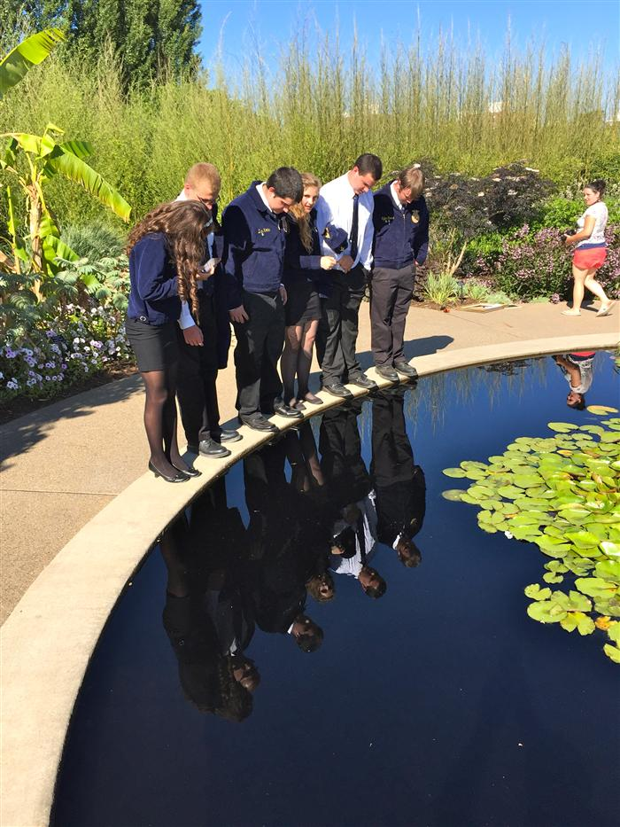 Little Lions FFA members gaze at a garden pool during the FFA state convention at Penn State.