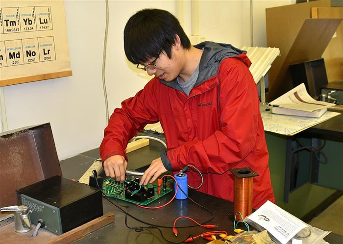 State High senior Vincent Liu works on a physics experiment.