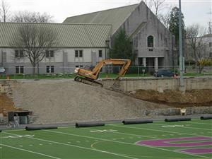 Gravel is spread where bleachers were removed
